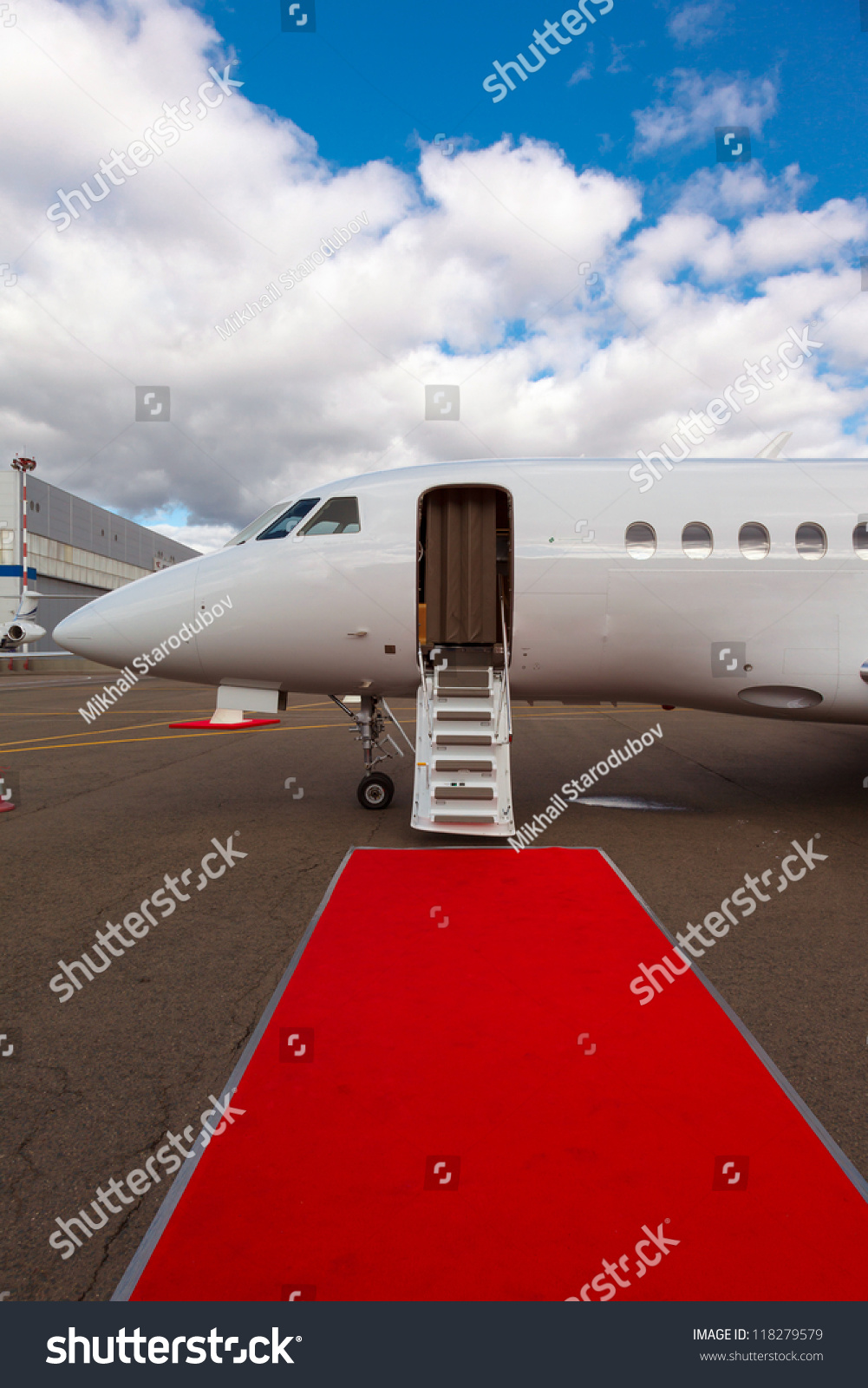 White Private Jet And Open Ladder Red Carpet At Airport Background Blue Sky