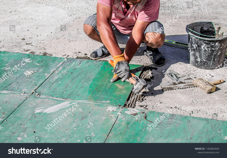 Laying Ceramic Granite Tiles On Glue Stock Photo (Edit Now