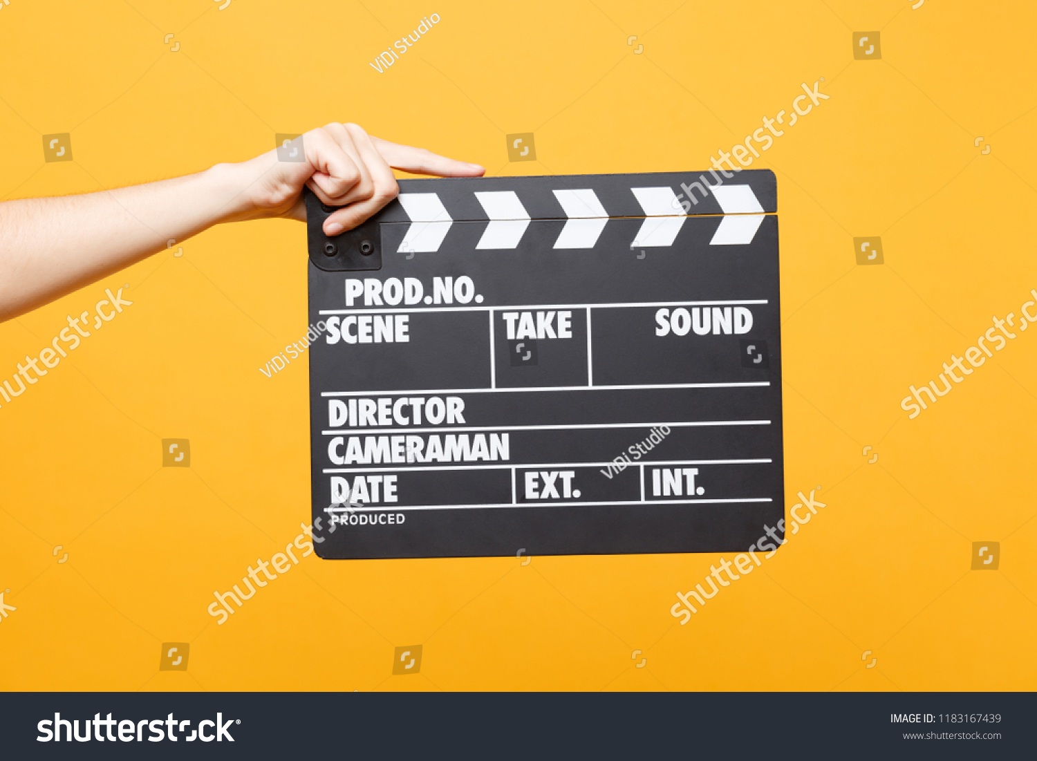Close up female holding in hand classic director clear empty black film making clapperboard isolated on yellow orange background. Cinematography production concept. Copy space for advertising #1183167439