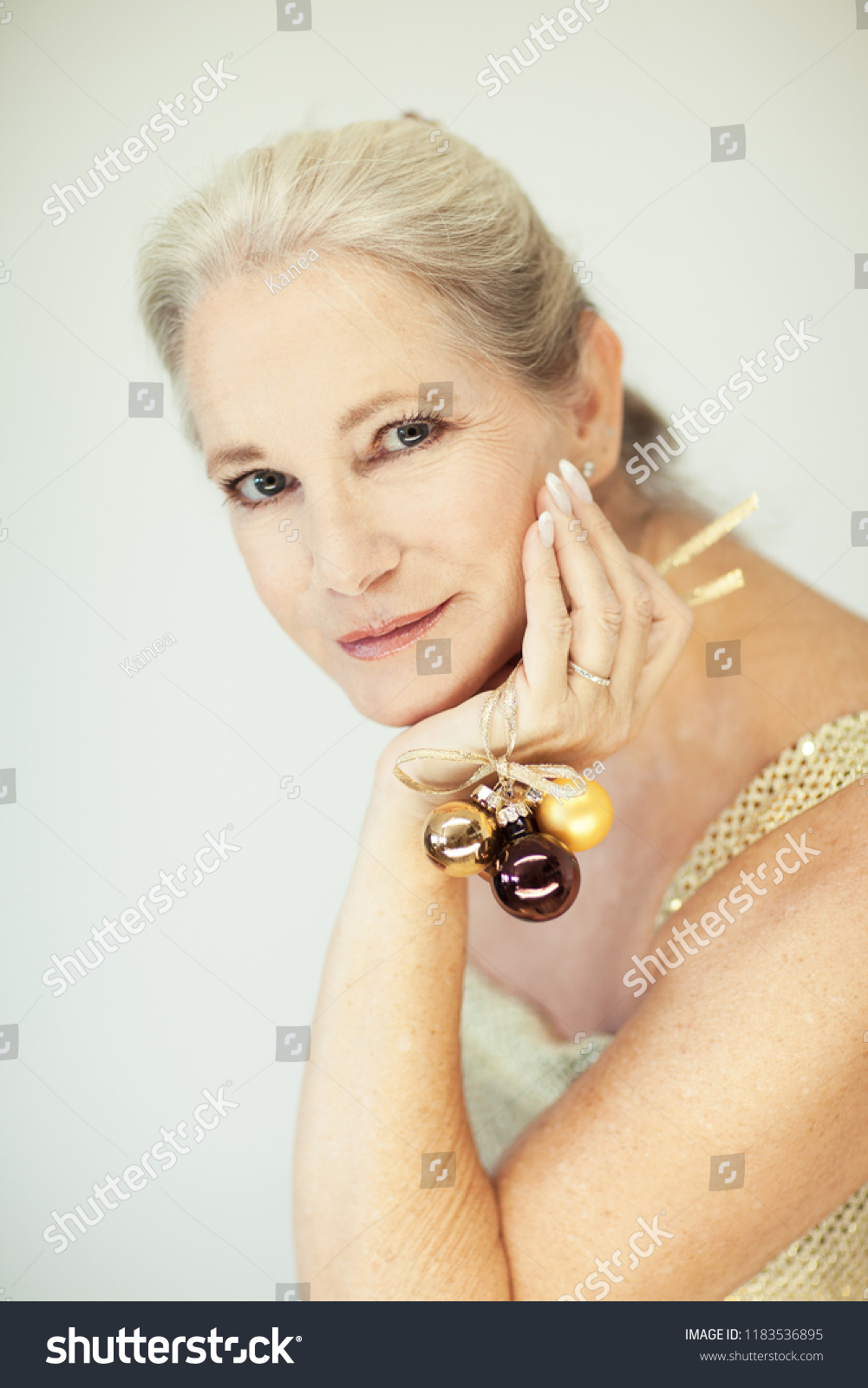 61928906a Stunning beautiful and self confident best aged woman with grey hair  smiling into camera