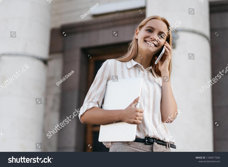 Portrait Happy Businesswoman Talking On Mobile Stock Photo
