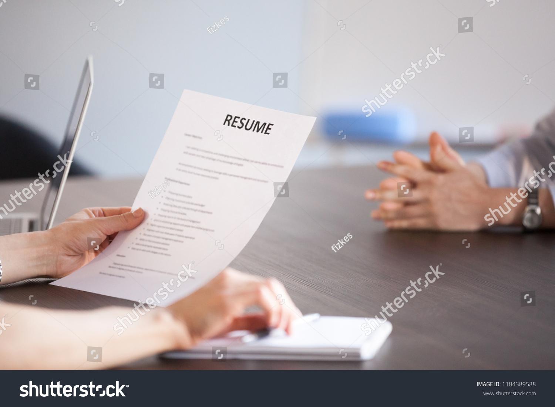 Hands Hr Holding Paper Resume Job Stock Photo Edit Now 1184389588