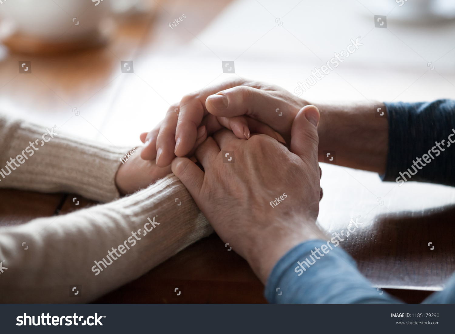 Old middle aged people holding hands close up view, senior retired family couple express care as psychological support concept, trust in happy marriage, empathy hope understanding love for many years #1185179290