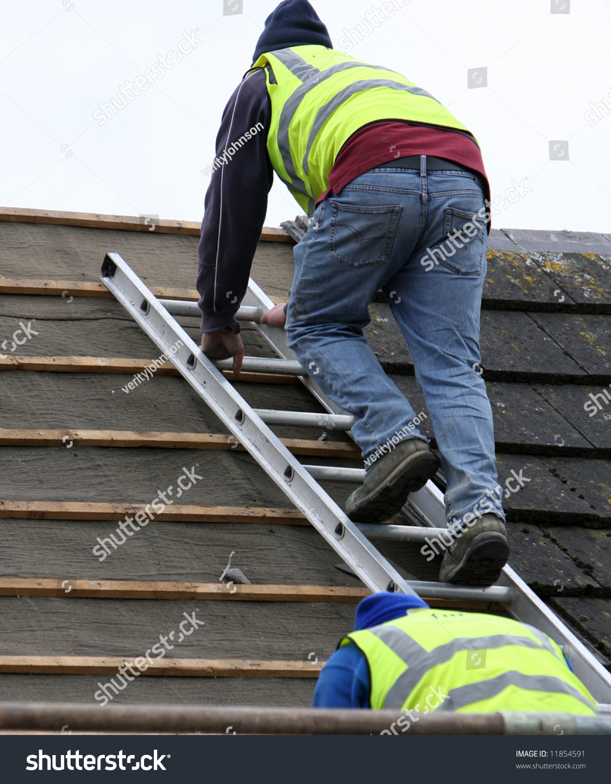 Two Men Using The Roofing Ladder To Take Slates Off