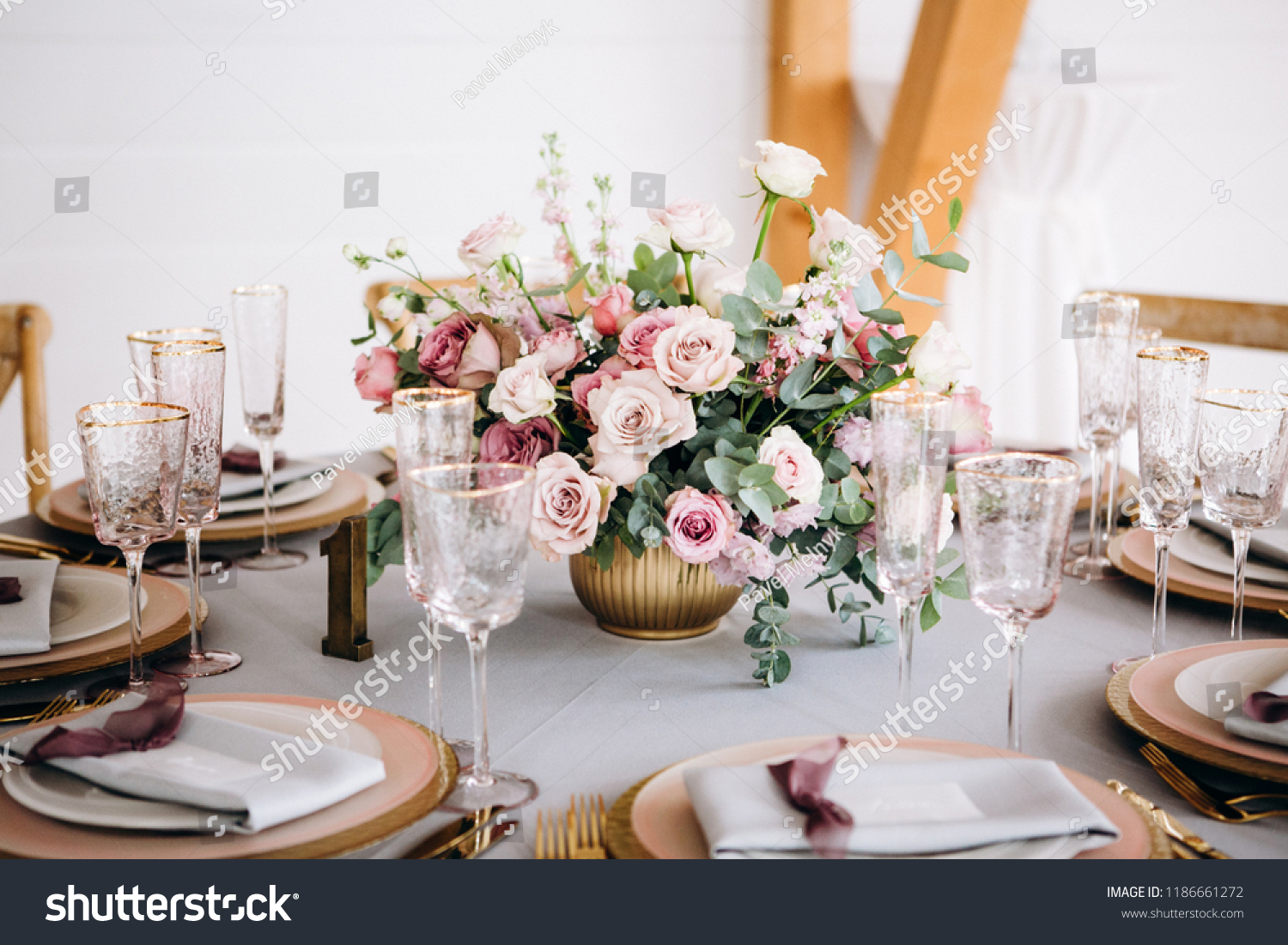 Amazing wedding table decoration with flowers on wooden tables #1186661272