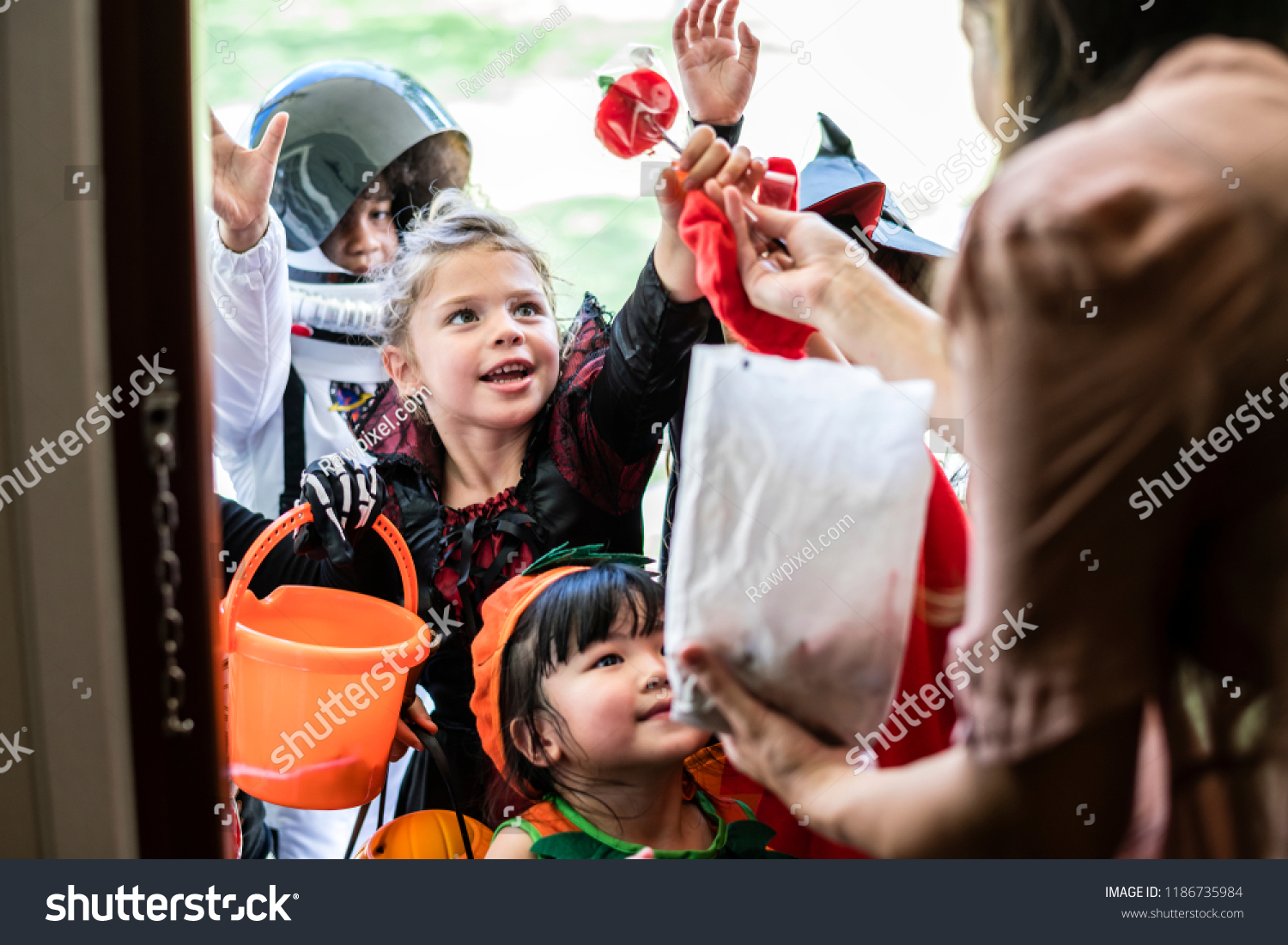 Little children trick or treating on Halloween #1186735984