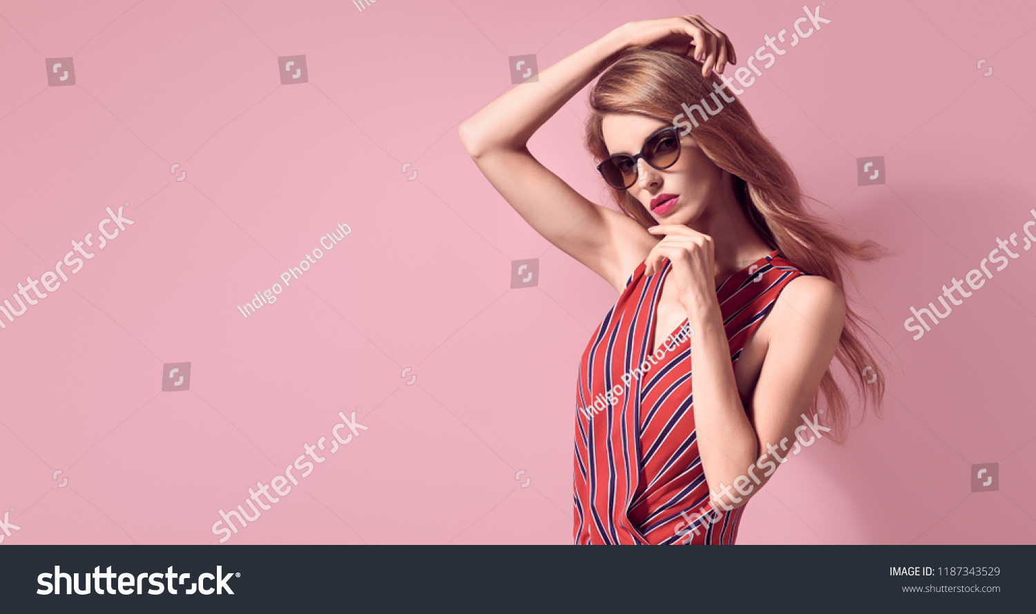 3f070a45e4a Sexy adorable Blonde Lady in Trendy striped blouse. Stylish Art Sensual studio  Portrait. Young