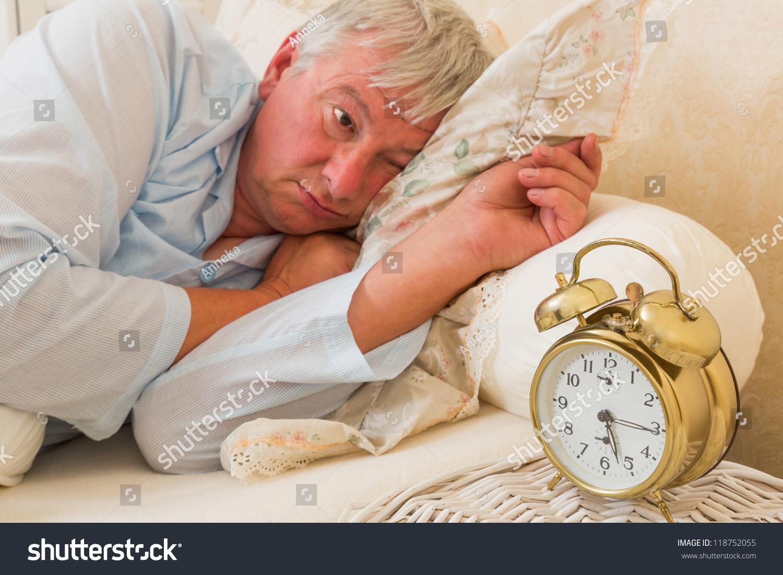 Sleepy Elderly Man Waking Looking Alarm Stock