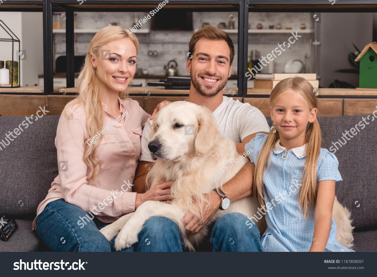 Parents Daughter Dog Sitting On Couch Stock Photo Edit Now