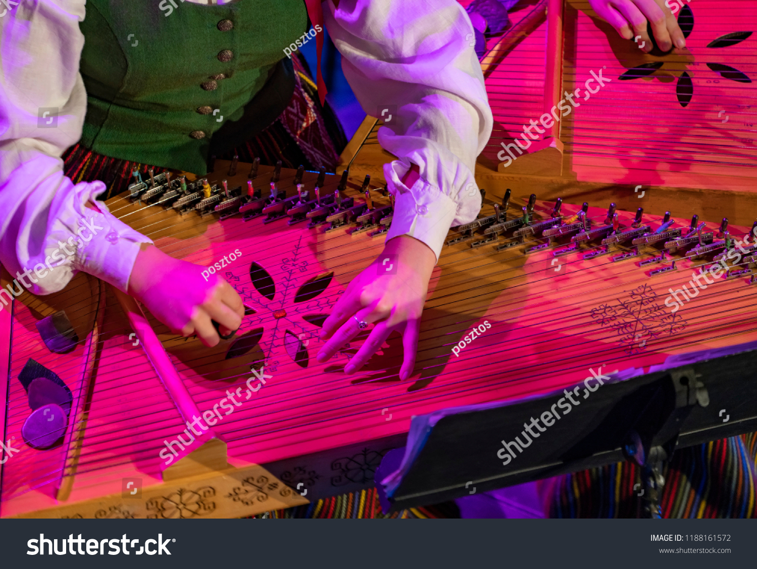 Hands playing on Kokle, a latvian plucked string instrument belonging to the Baltic box zither family #1188161572