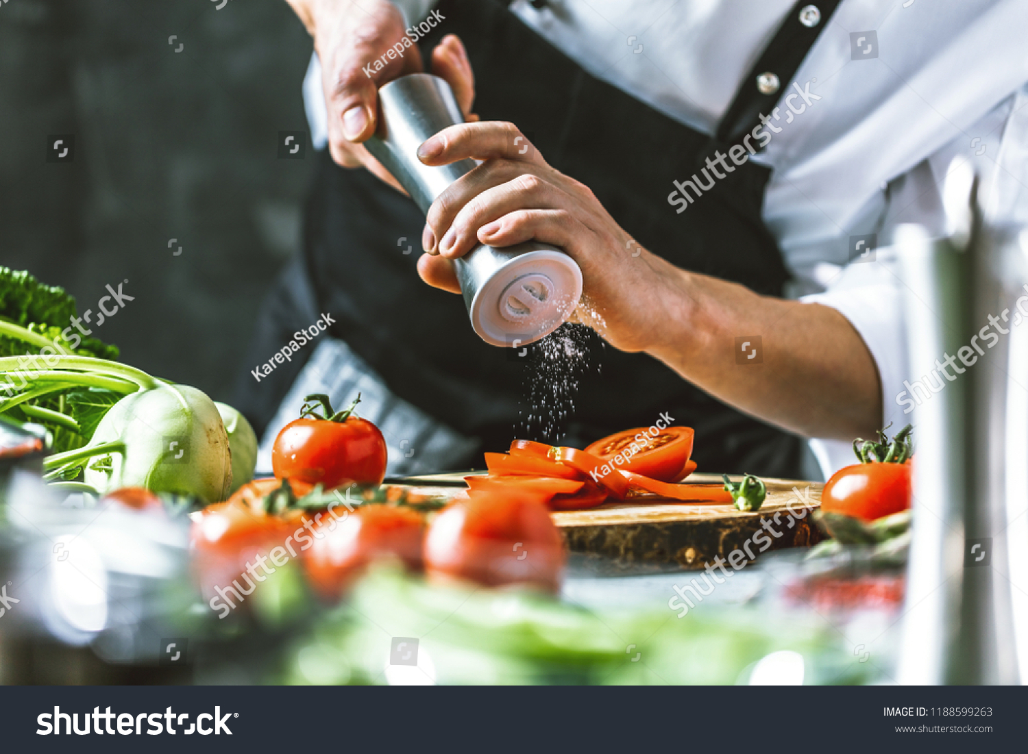 Chef cook preparing vegetables in his kitchen. #1188599263
