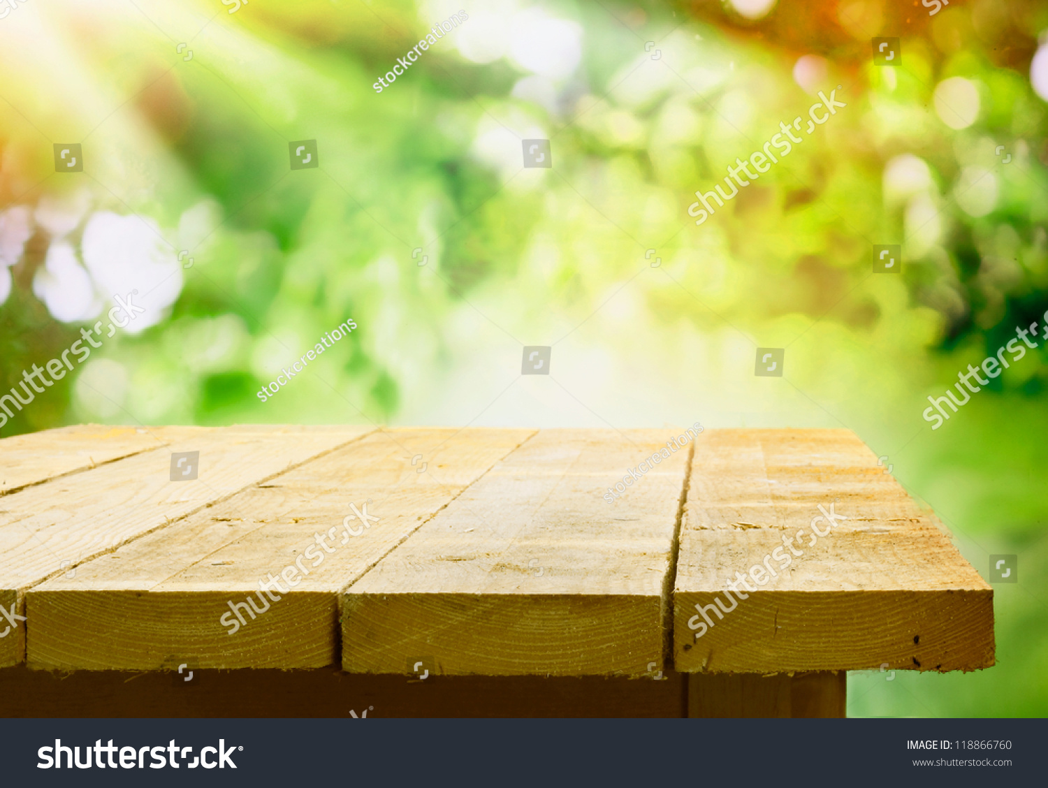 Empty wooden table garden bokeh catering stock photo