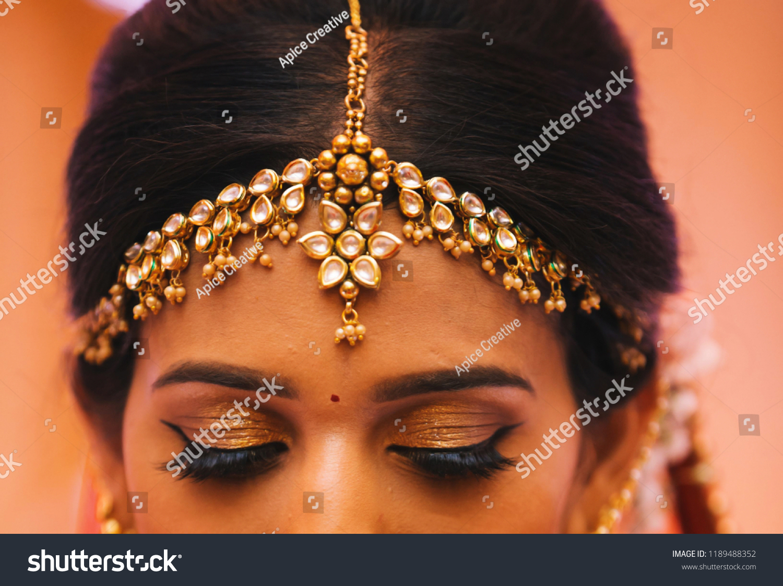 Indian bride's Showing Eye Makeup and Tika jewelry Karachi, Pakistan, September 01, ...