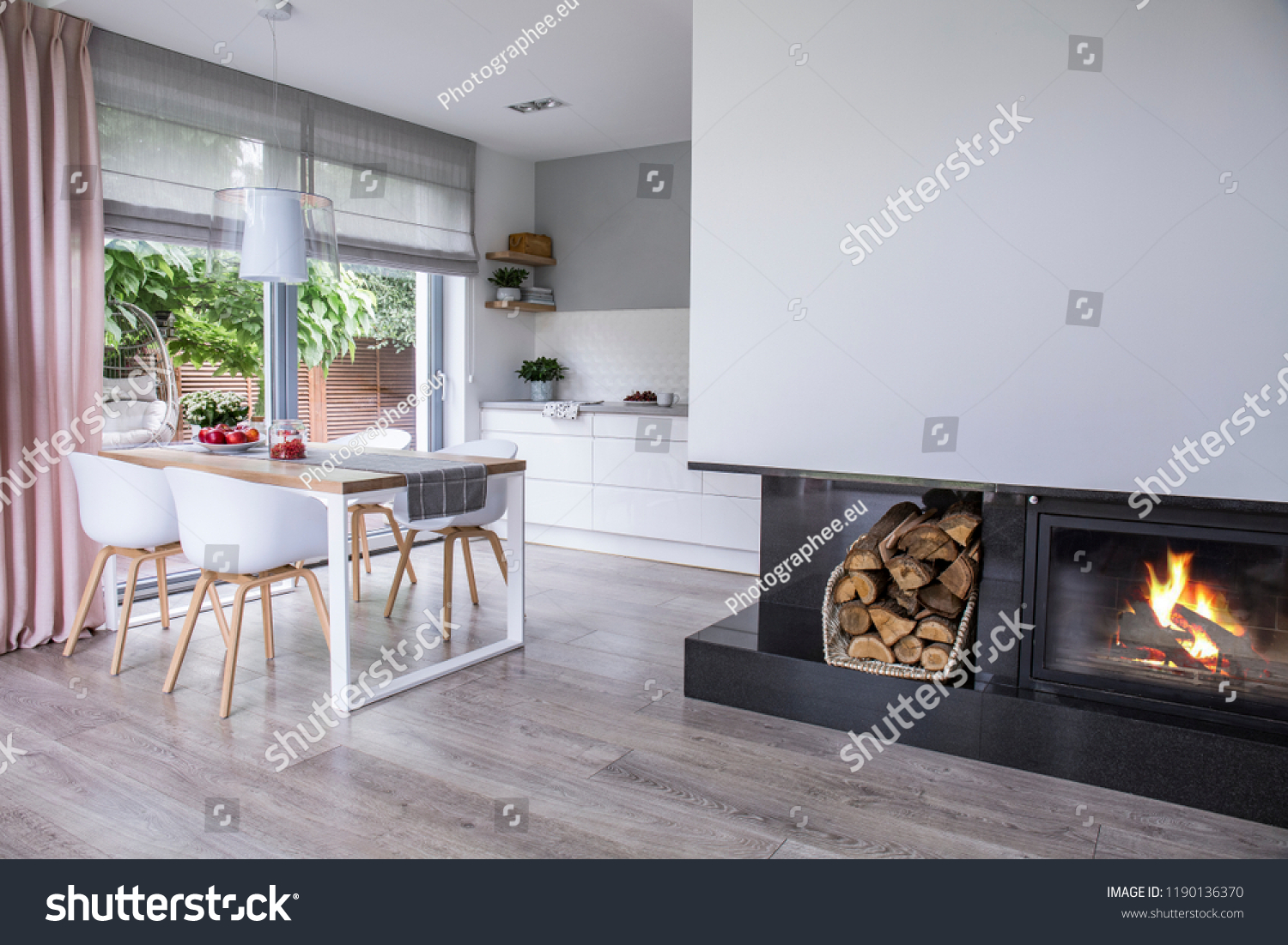Real Photo Of A Fireplace In Modern Kitchen And Dining Room Interior Empty Wall