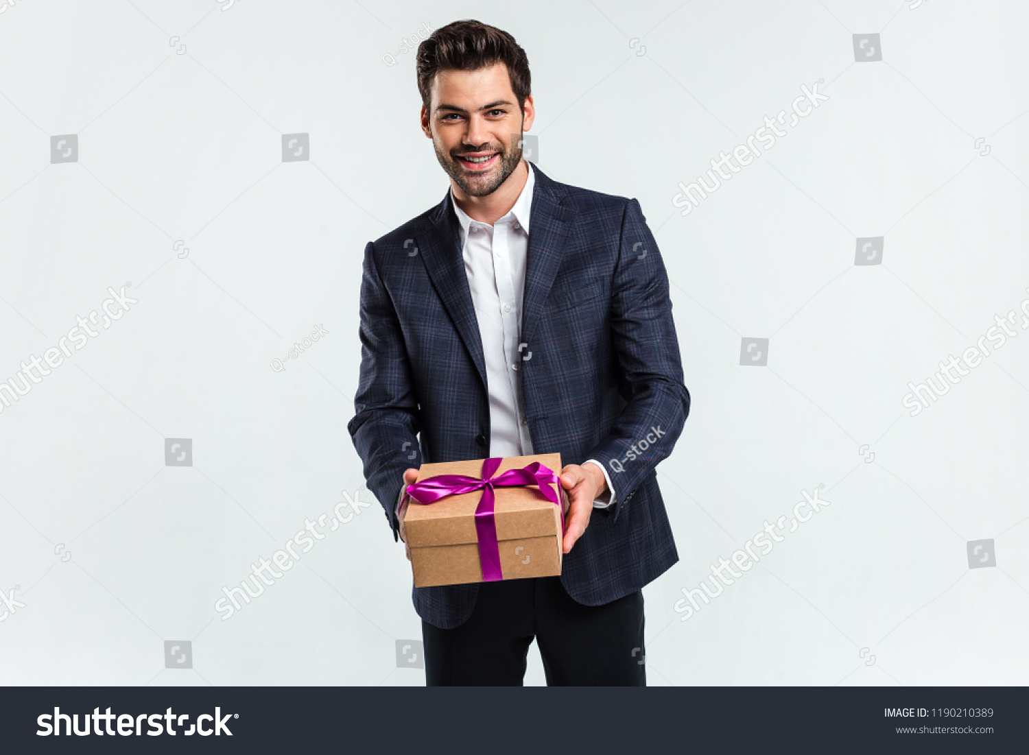Your Birthday Gift Handsome Young Man Holding A Present Box And Looking At Camera With