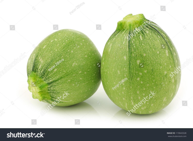 one light green and a green round zucchini cut zucchini cucurbita pepo on a white background. Black Bedroom Furniture Sets. Home Design Ideas