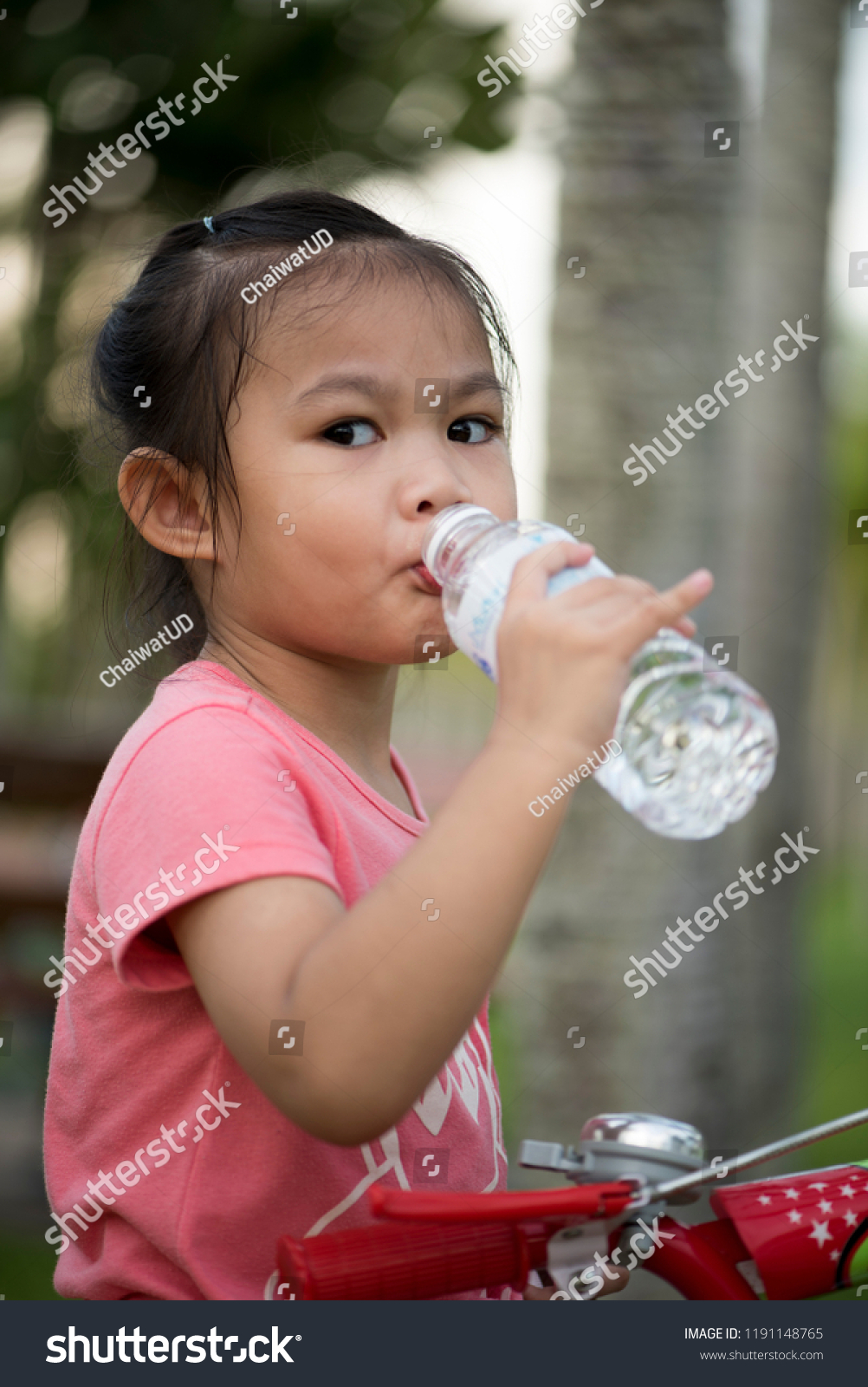 Asian girl drinking water. Asian girls ages cute. Asian child with  emotional expression, 2 year old girl 8 months - Image