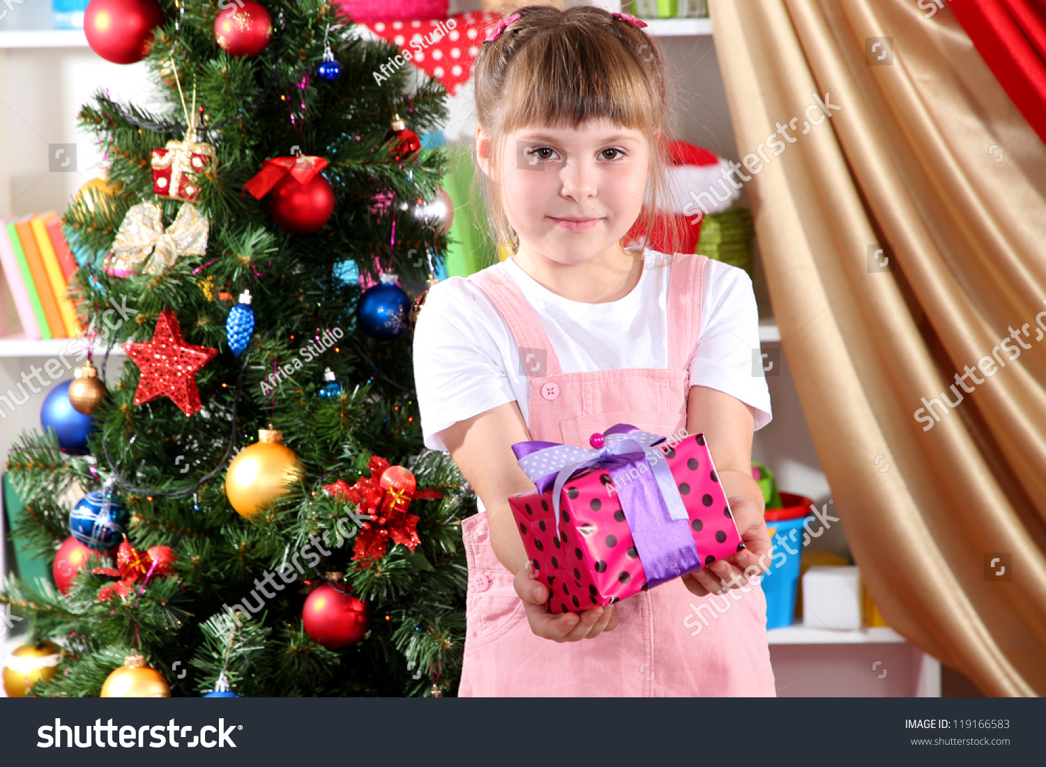 Little Girl Toys : Little girl with christmas toys in festively decorated