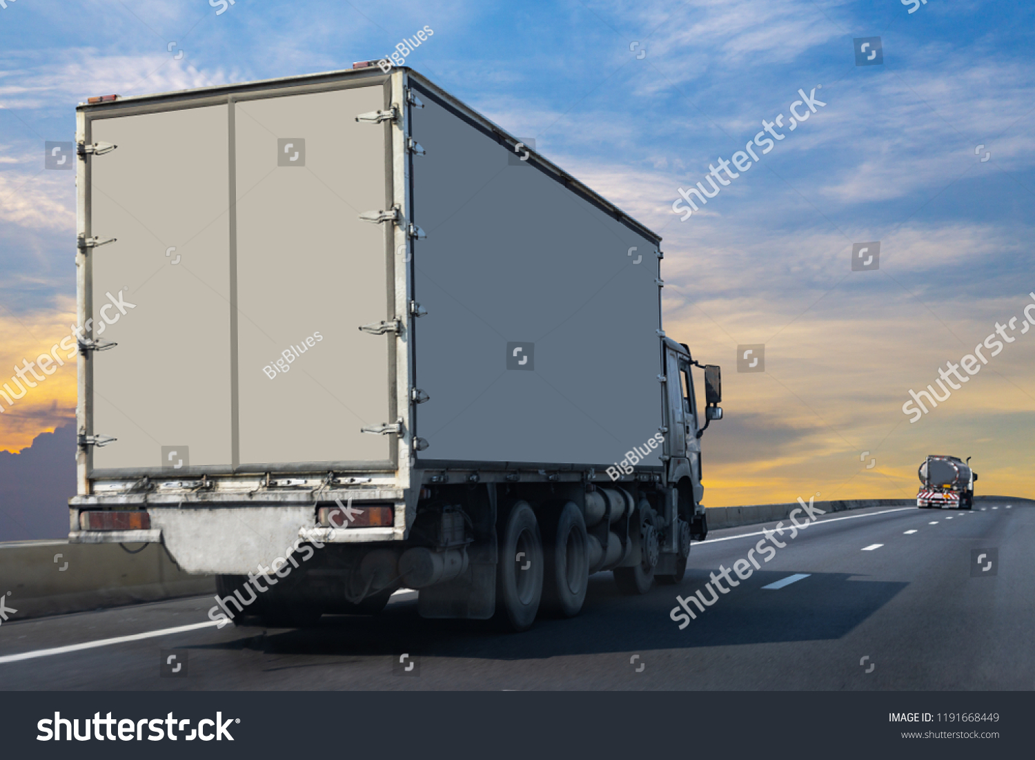 White Truck on highway road with  container, transportation concept.,import,export logistic industrial Transporting Land transport on the asphalt expressway  #1191668449
