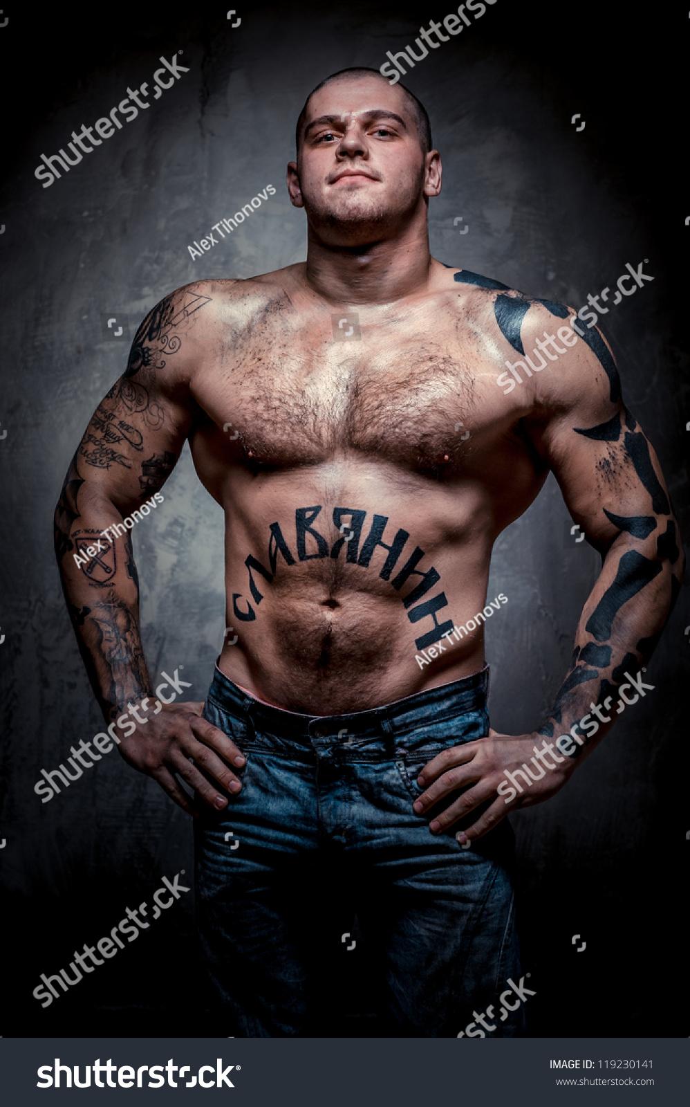young tattoos many muscular grey posing shutterstock