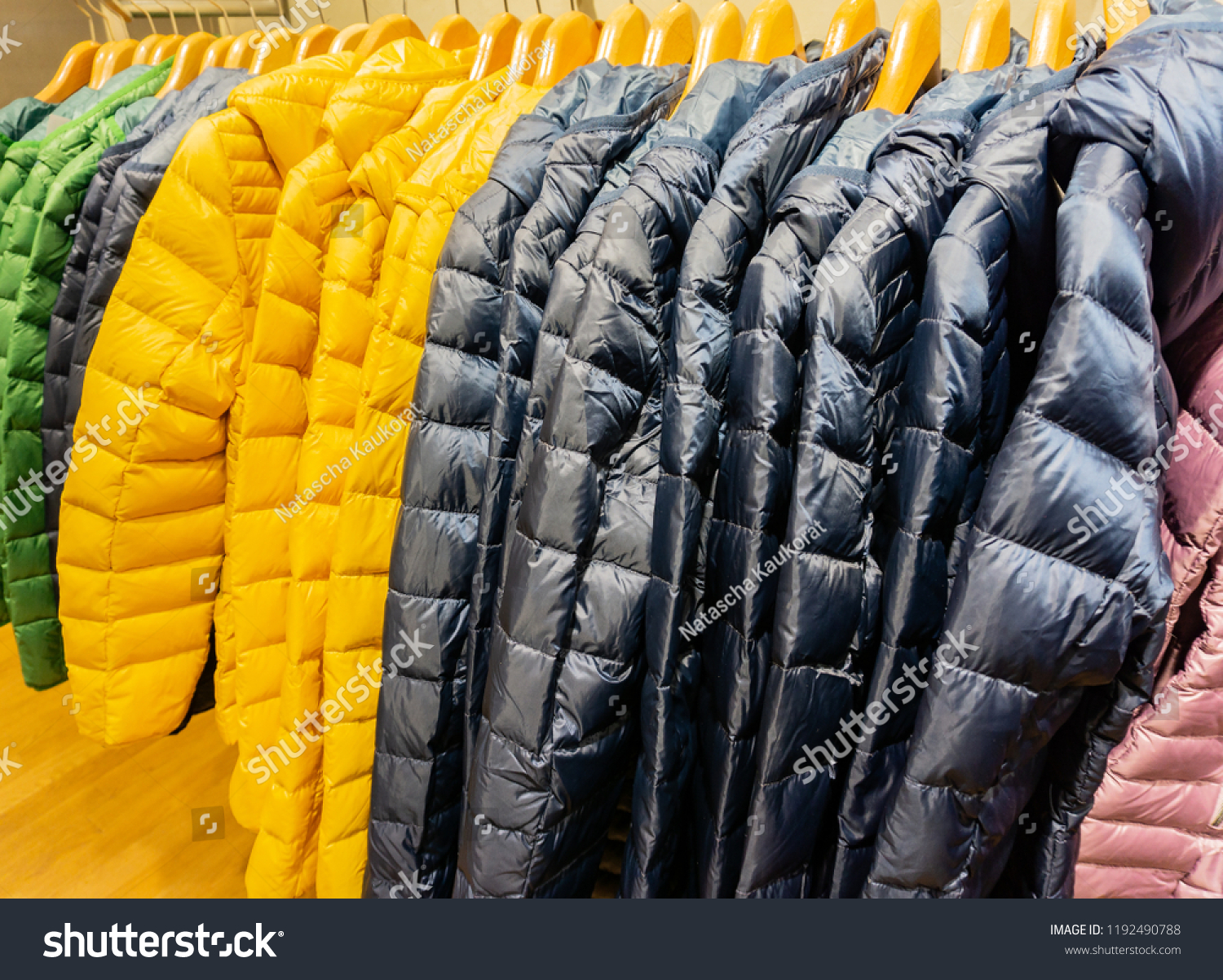 Winter fashion down jackets on a clothes rack #1192490788