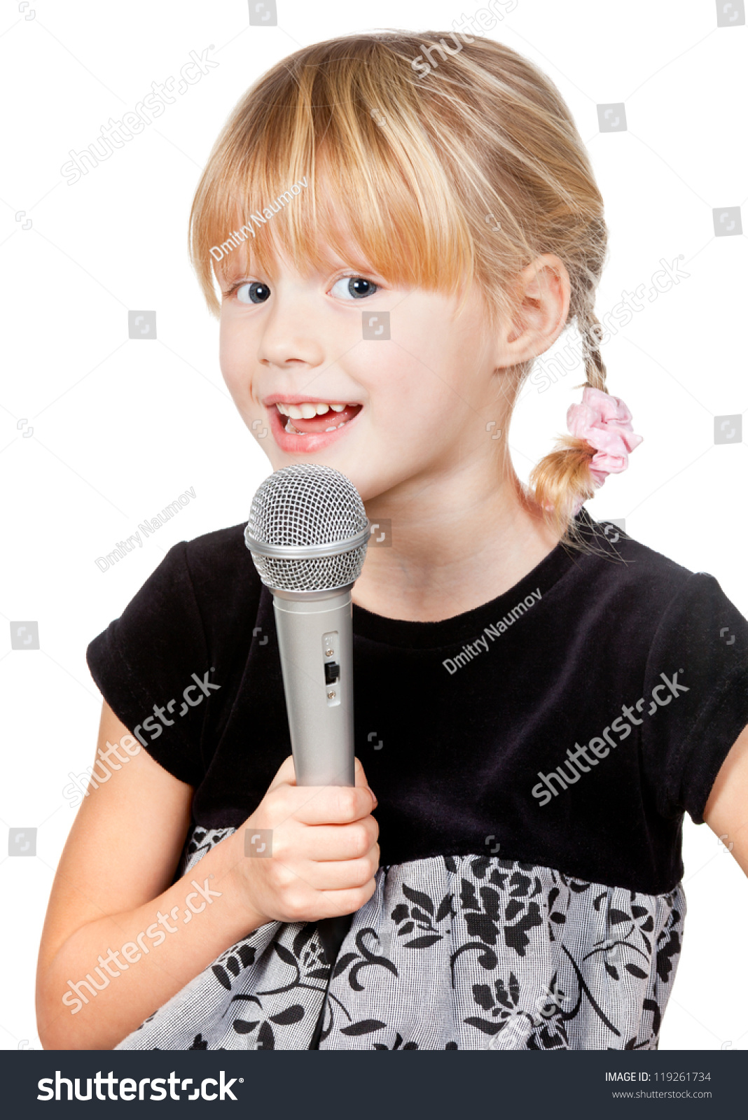 Cute Little Girl Singing Holding Microphone Stock Photo ...