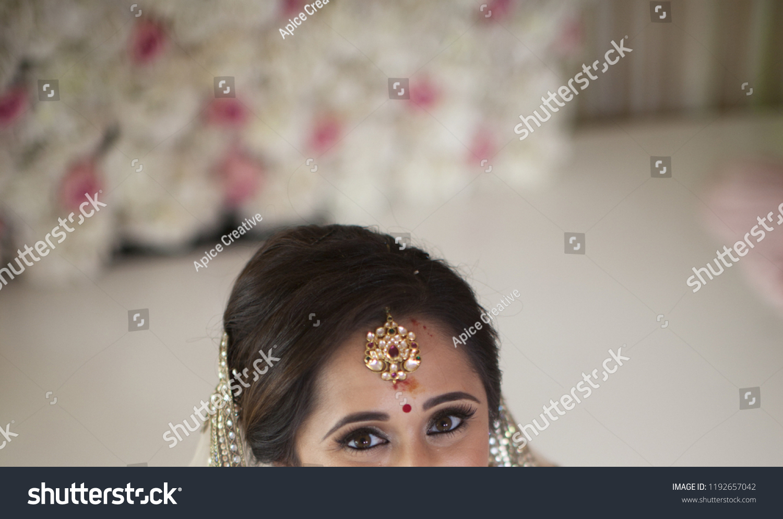 Indian bride's Showing Eye Makeup and Tika jewelry Karachi, Pakistan, September, 01,