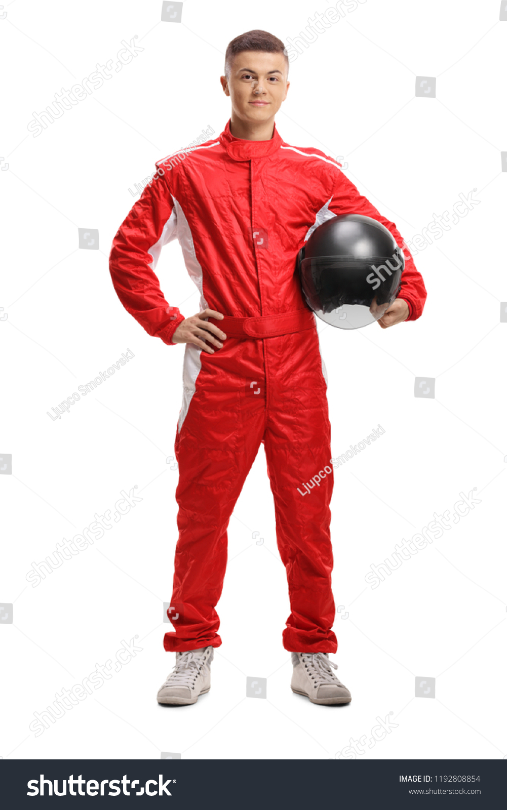 Full length portrait of a racer with a helmet isolated on white background #1192808854