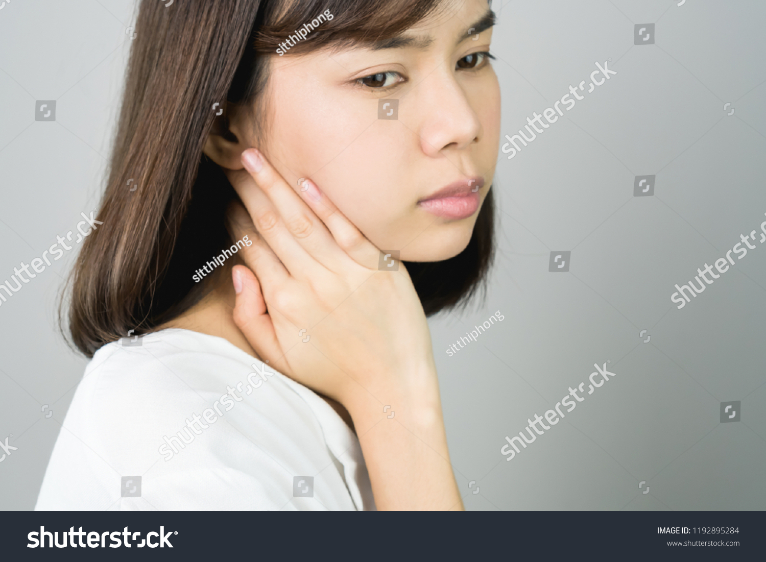 Asian girl in white casual dress catch that shoulder, Because of the pain  of hard