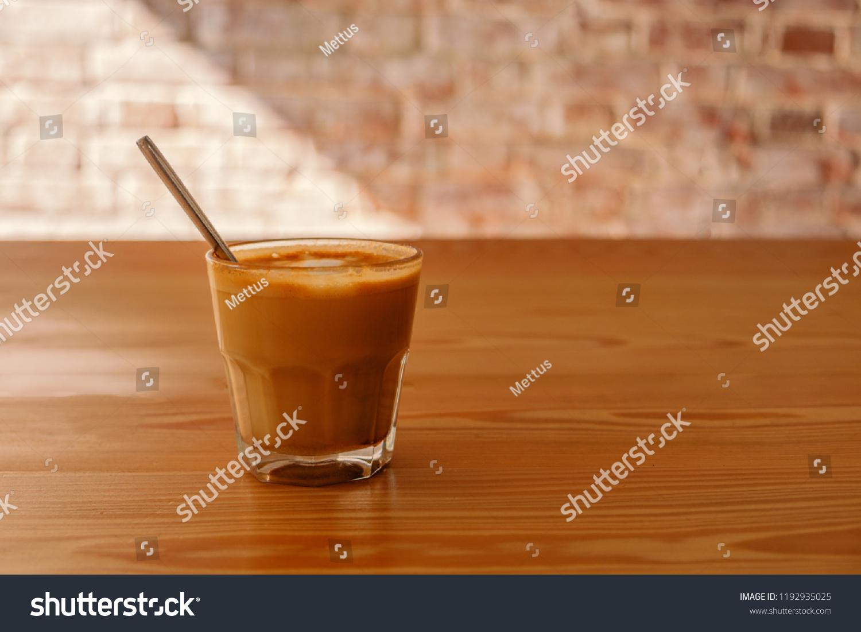 stock-photo-flat-white-coffee-in-transpa