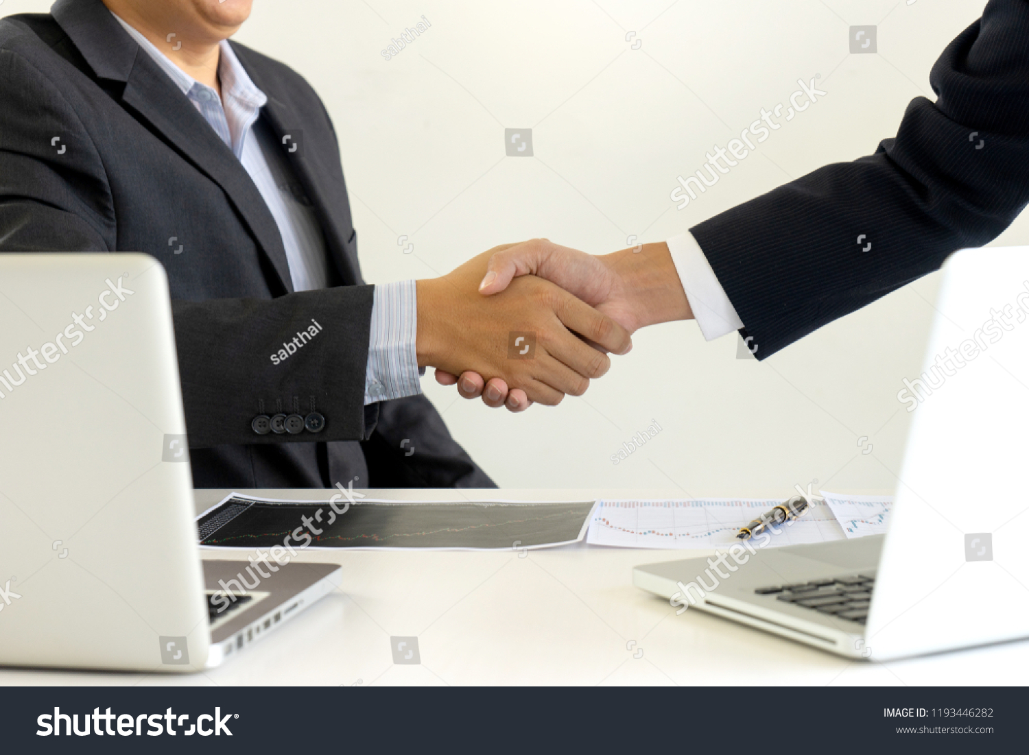 Businessman Shake Hand Office Table Between Stock Photo Edit Now