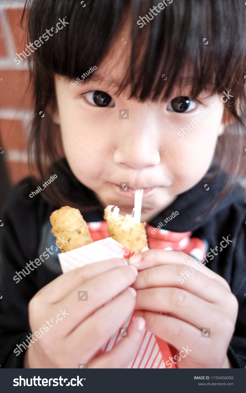 32fe14dafd Little Girl Eating Cheese Sticks Happily Stock Photo (Edit Now ...