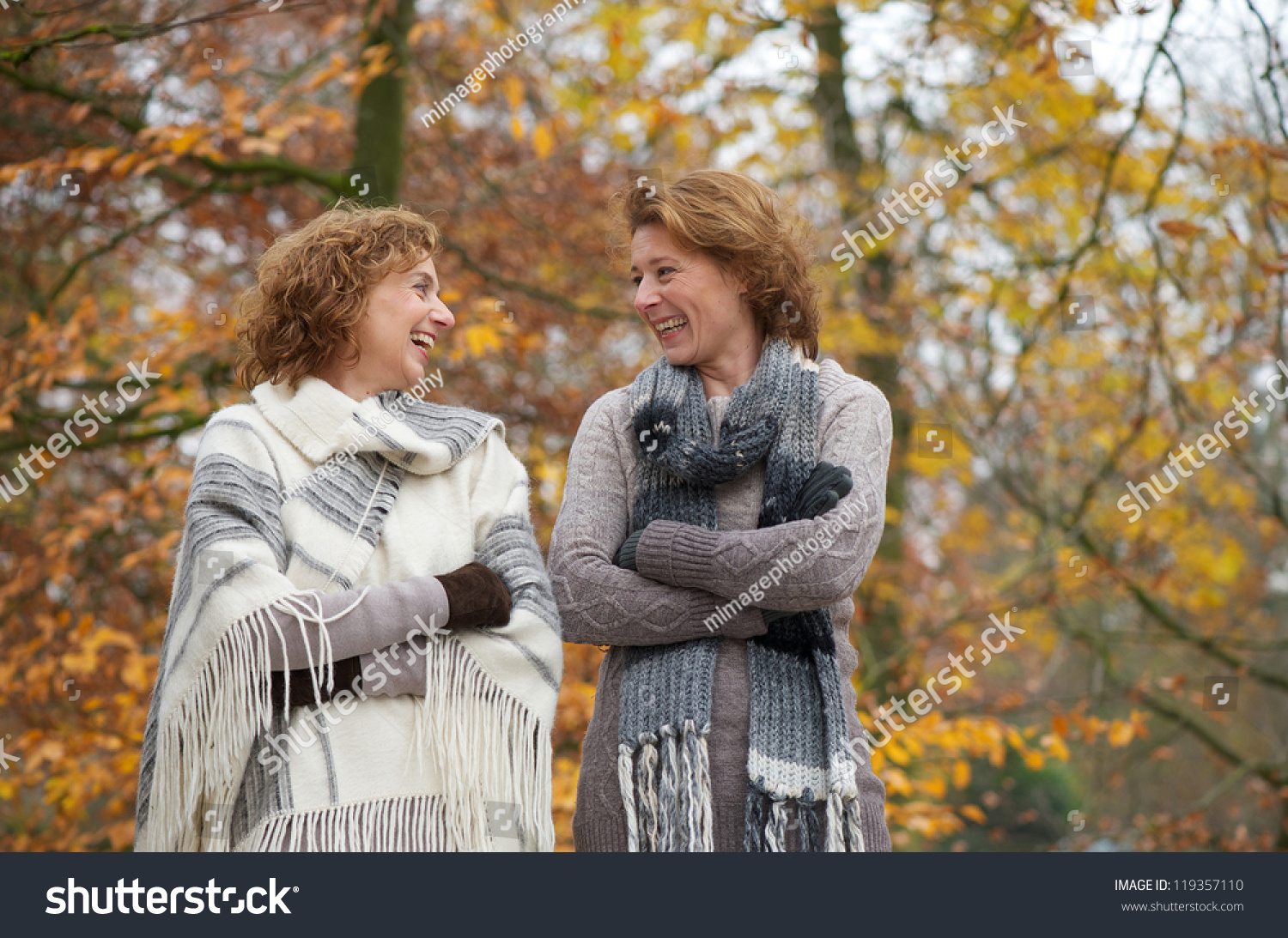 portrait two older women smiling outdoors stock photo 119357110