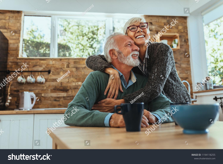 Mature woman hugging her husband #1194118255