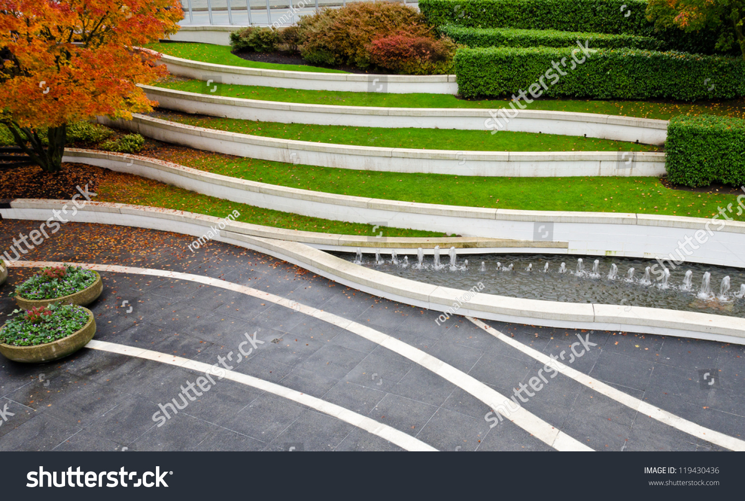 Leveled terraces grass fountains city plaza stock photo for Landscape design canada