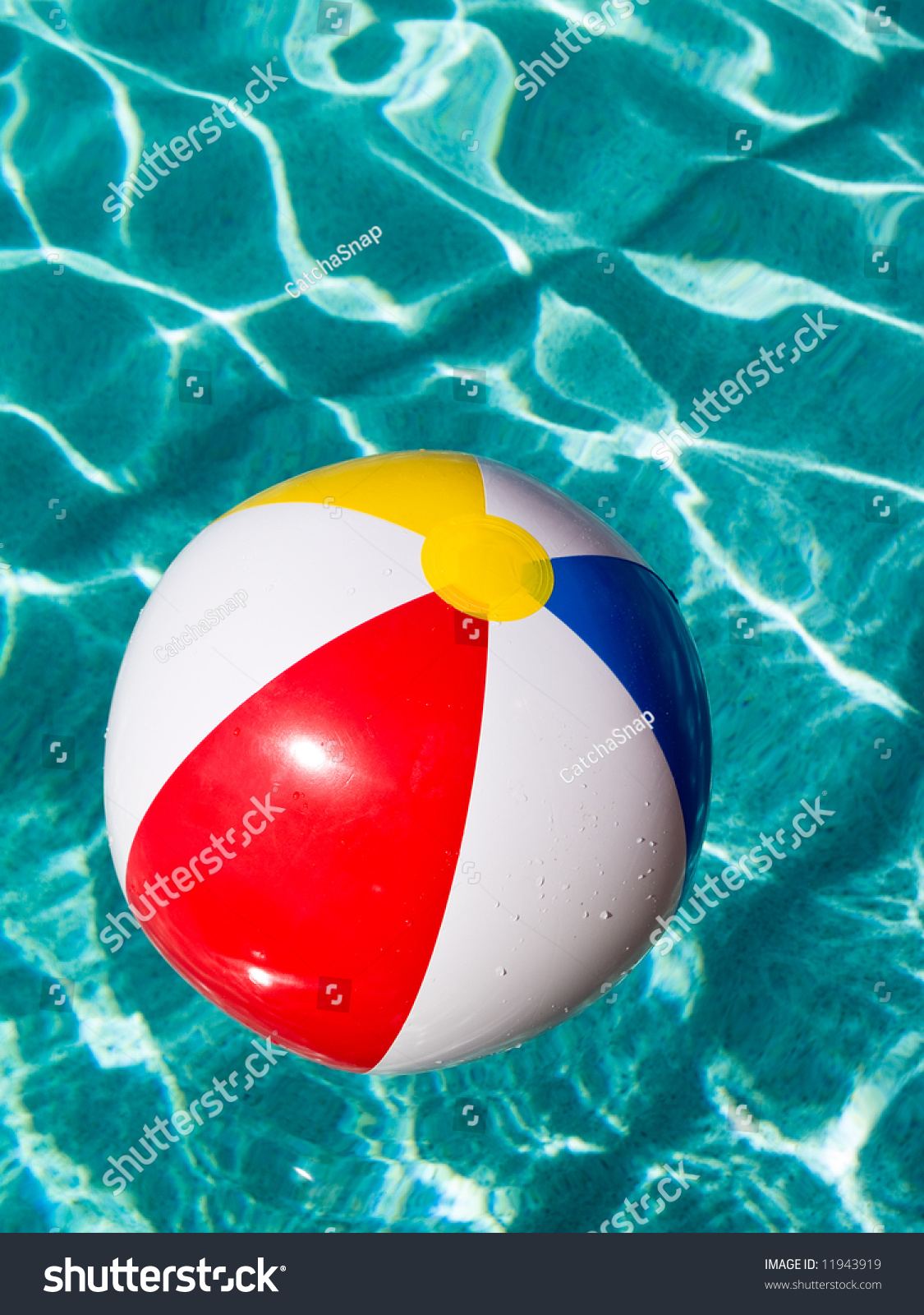 Pool Water With Beach Ball beach ball floating swimming pool stock photo 11943919 - shutterstock