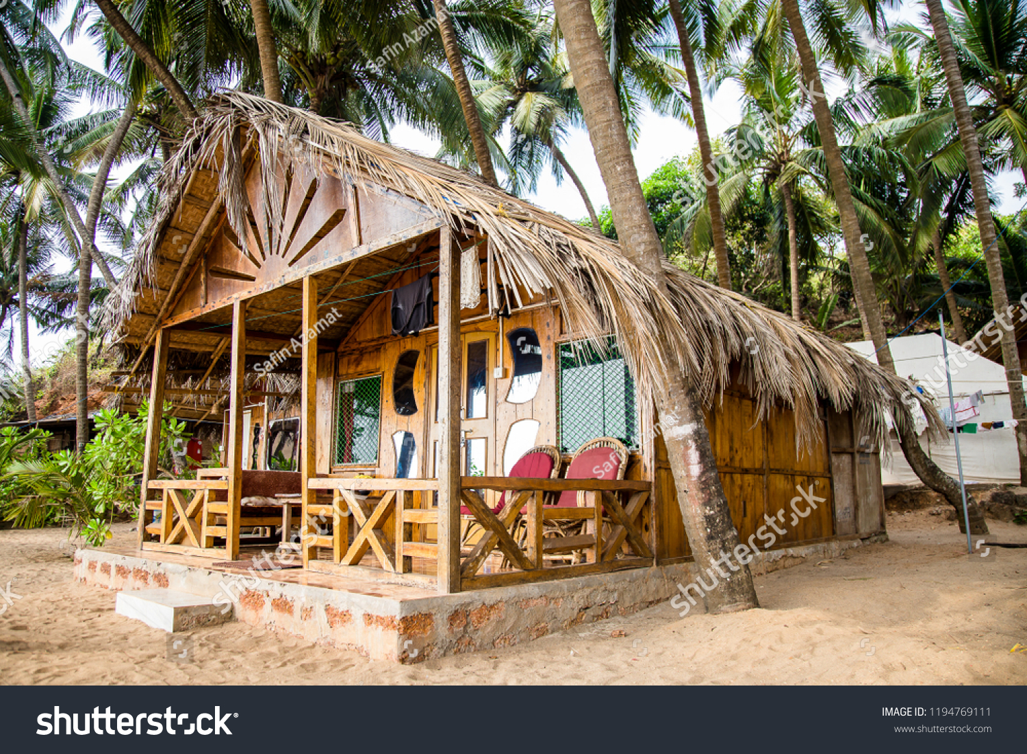 bungalow palm grove stock photo (edit now) 1194769111 - shutterstock
