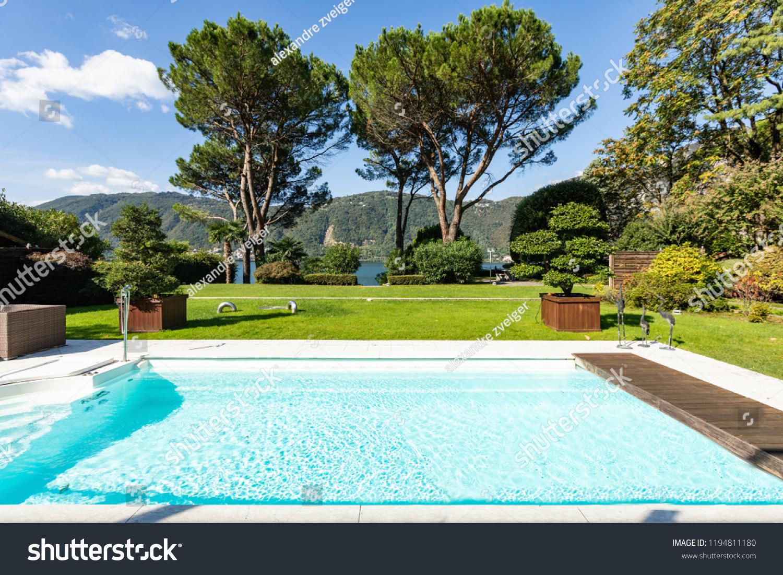 Garden With Swimming Pool exterior swimming pool garden lake view stock photo (edit