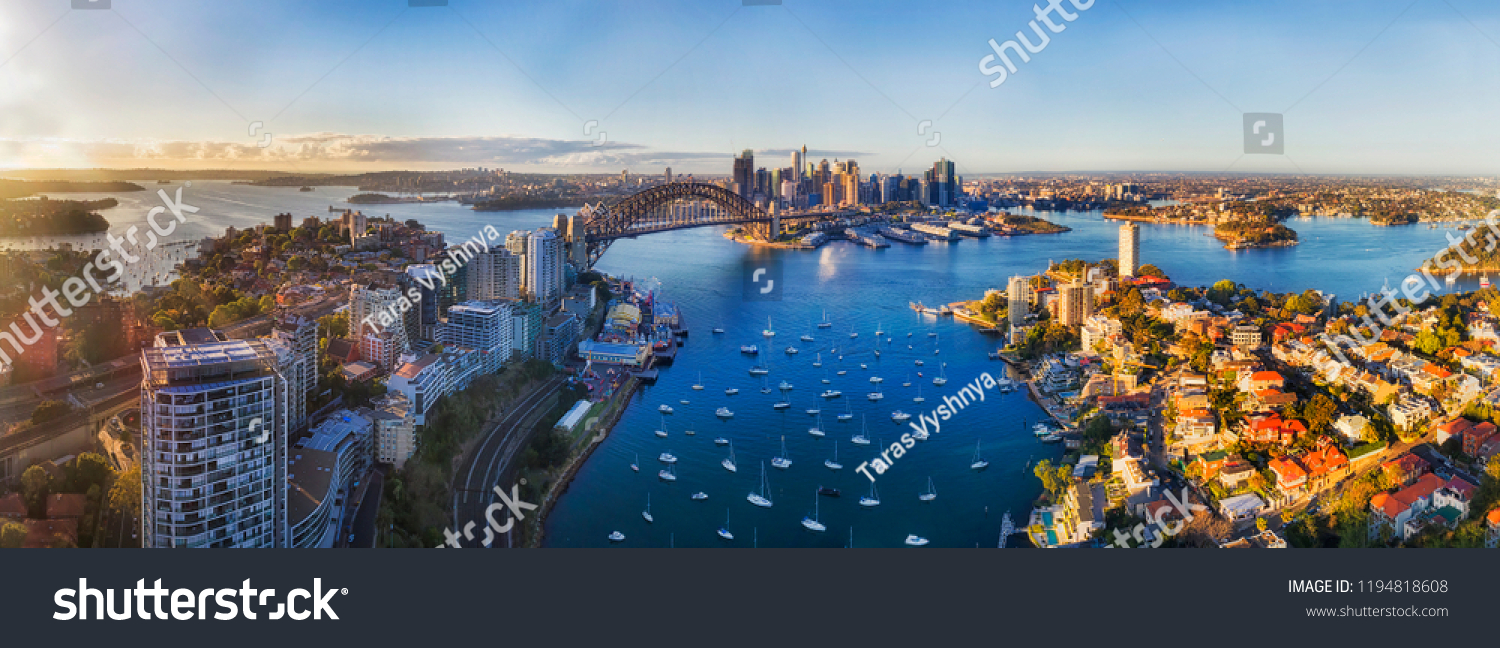 Soft sunlight in the morning over Sydney city CBD landmarks around Harbour and Lavender bay from Lower North SHore along Sydney Harbour bridge and The Rocks with Barangaroo. #1194818608