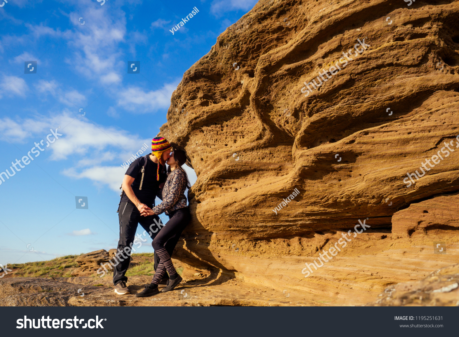couple in love on a canyon trip. Man brave red-haired beard climbing  bouldering stone rock tourist climbs up with backpack in a black T-shirt  and a funny ... 7885088896c3