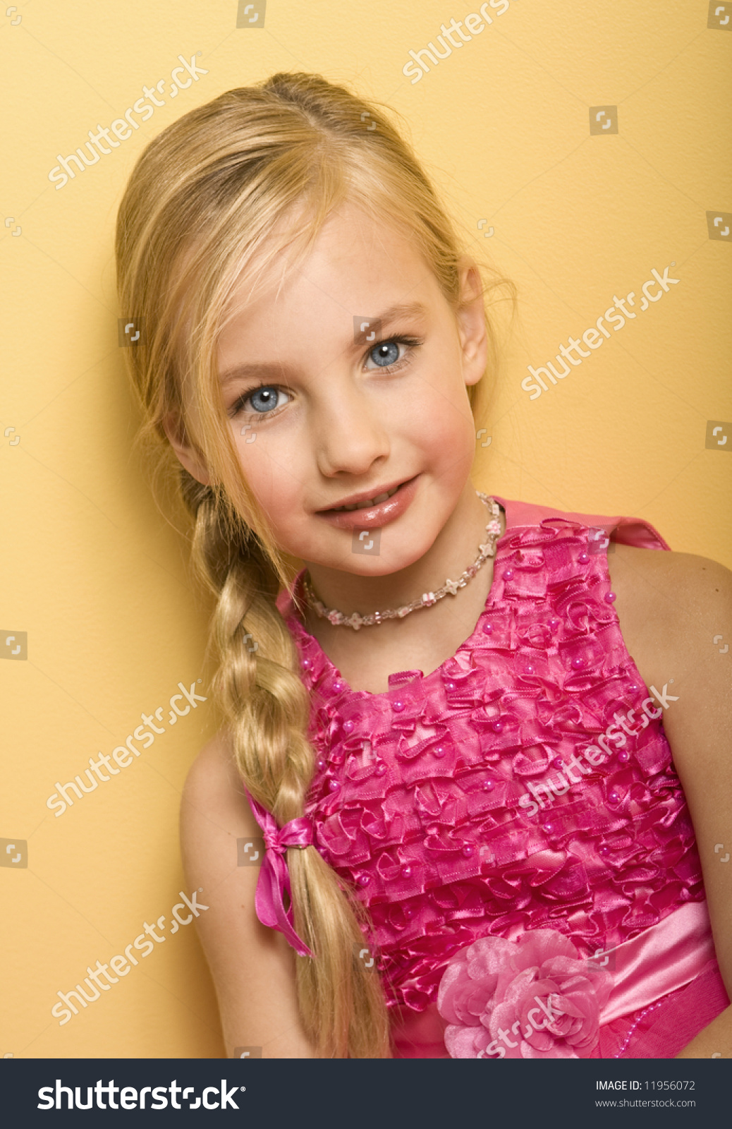 Beautiful Blond Five Year Old Girl In A Pink Dress Yellow
