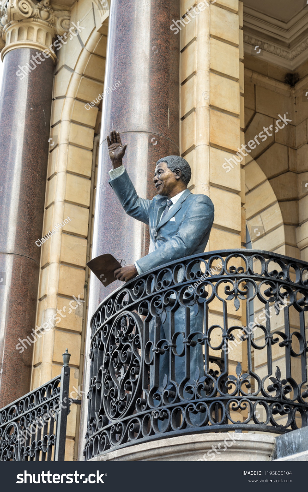 CAPE TOWN, SOUTH AFRICA - SEPTEMBER 14, 2018: A Statue of Nelson Mandela waving is placed on the balcony of Cape Town City Hall overlooking the Grand Parade public square was unveiled on July 24,2018.