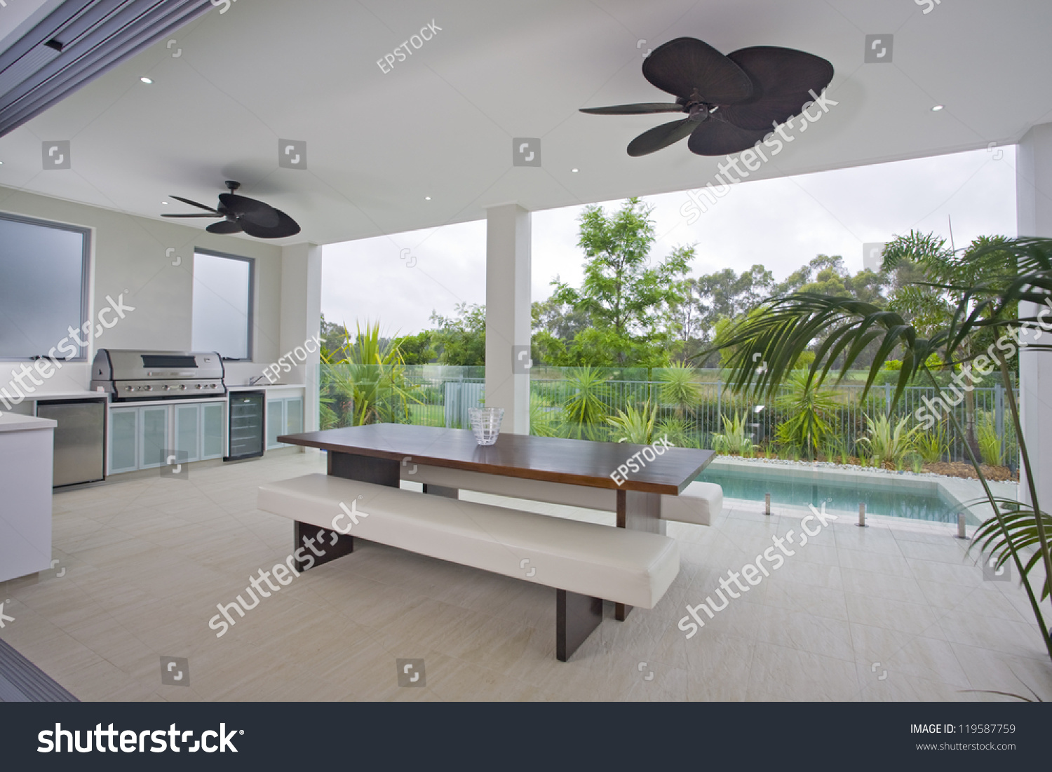 Outdoor entertaining area with swimming pool photo libre de droits 119587759 shutterstock for Swimming pool entertaining areas