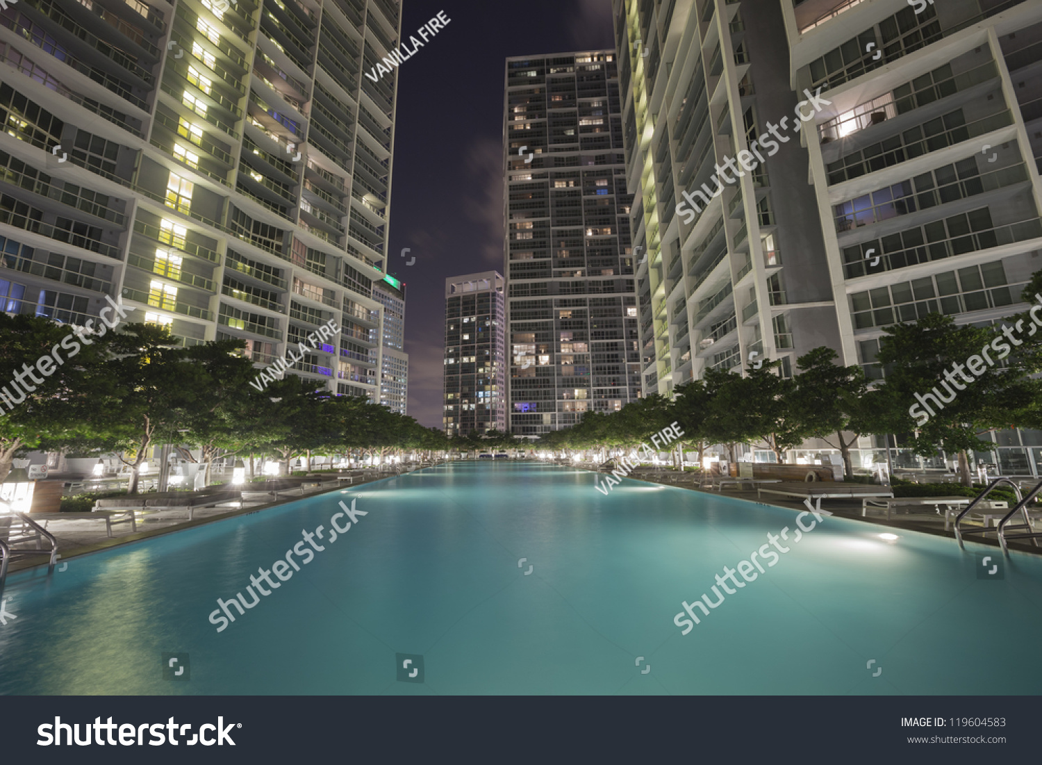 Swimming pool among high rise buildings stock photo 119604583 shutterstock for Houston swimming pool high rise