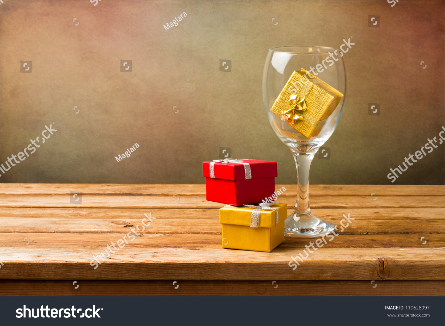 Empty wine glass with gift boxes on wooden table over for Empty wine crates