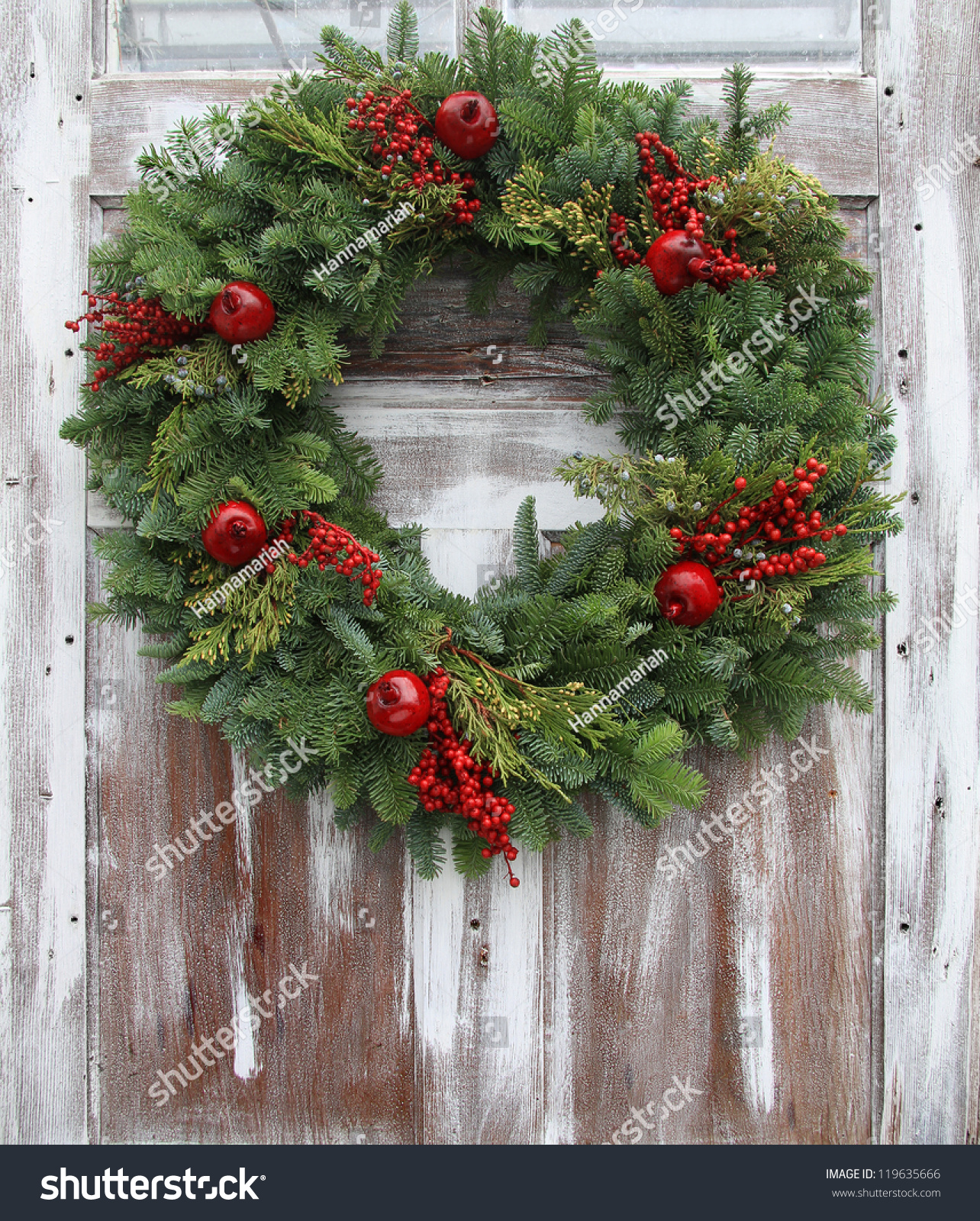 Christmas Wreath On Rustic Wooden Front Stock Photo
