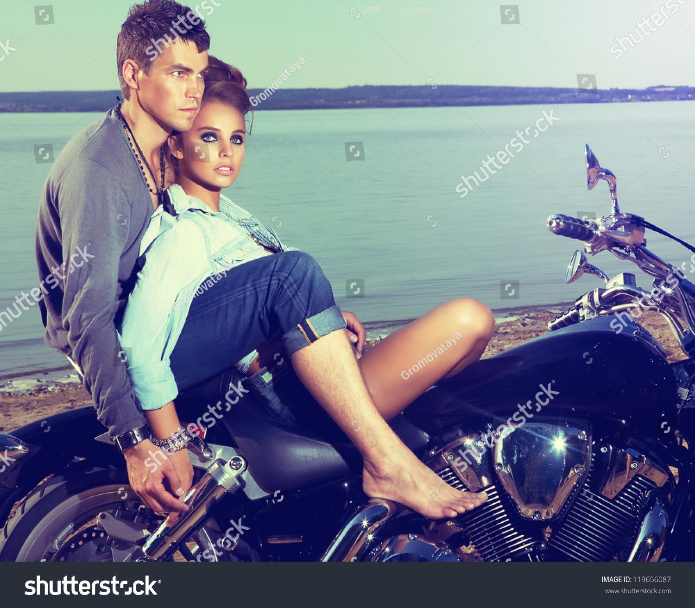 Beautiful Couple Family Sitting On Lake Stock Photo