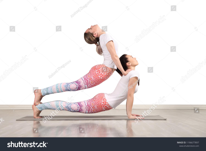 Young Female Acrobats Make Beautiful Acrobatic Stock Photo