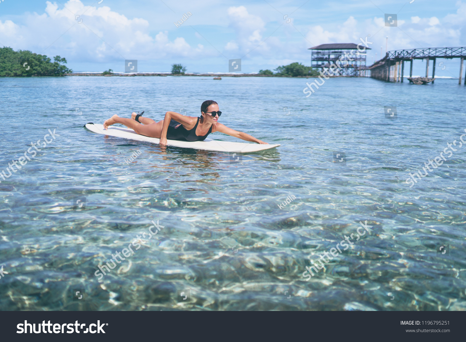 08d32adc3a7 Hobby and vacation. Sunny holiday on the beach. Young surfer woman surfing  having fun