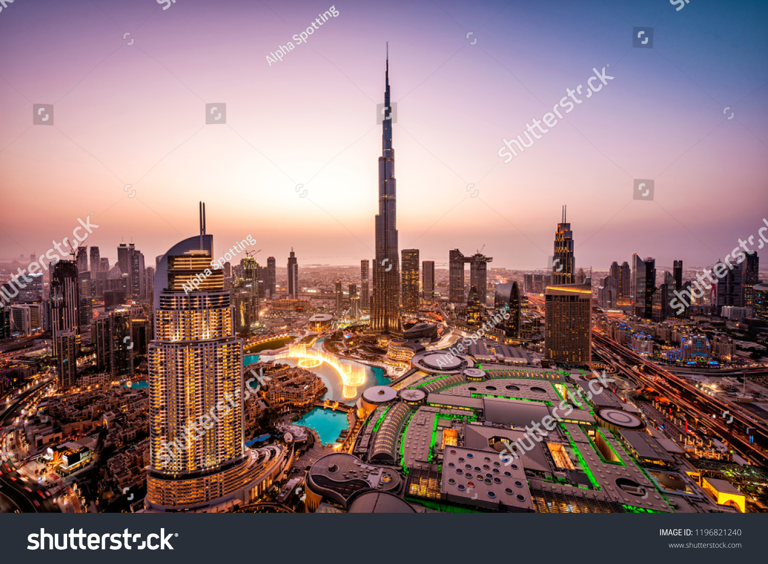 WOW view of Dubai skyline at night. City lights popping. Dancing fountain display. Luxury travel holiday concept.   #1196821240